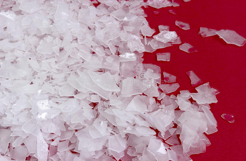 Magnesium chloride, nigari flakes. Magnesium chloride flakes -sea salt - close up royalty free stock photography