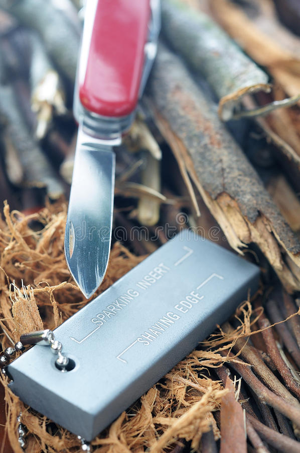 Magnesium fire starter. And pocket knife stock image