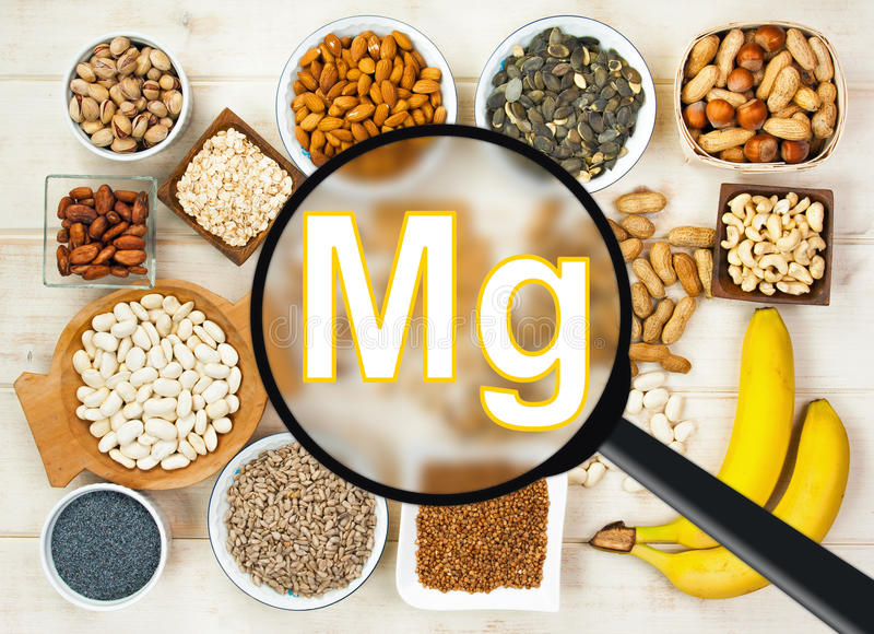 Magnesium in food. Collection natural products containing magnesium - pumpkin seeds, poppy seed, cashew nuts, beans, raw cocoa beans, almonds, sunflower seeds stock images