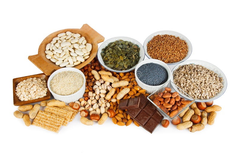 Magnesium in food. Natural products containing magnesium as pumpkin seeds, blue poppy seed, sesame seeds, beans, raw cocoa beans, almonds, sunflower seeds royalty free stock image