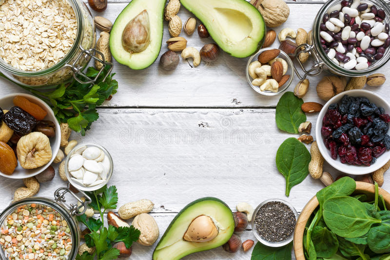Magnesium reach food on white wooden table. Healthy food. top view with copy space stock photography