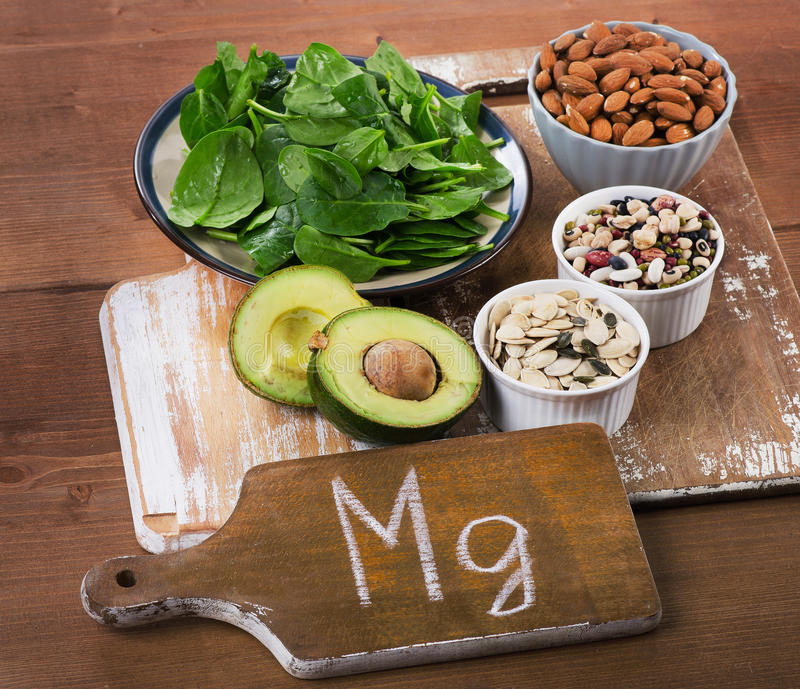 Magnesium Rich Foods. On a wooden table stock photos