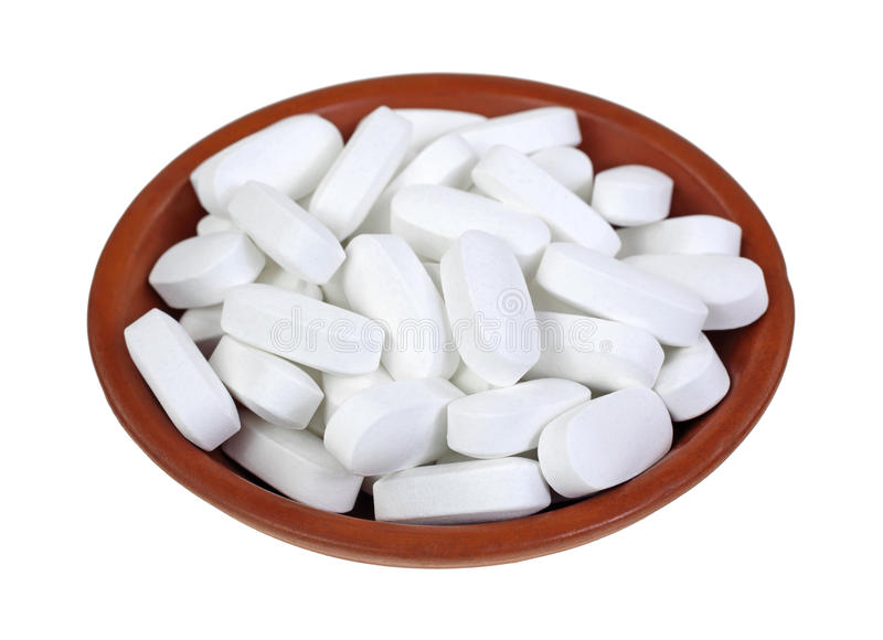 Magnesium Tablets. A small dish of high potency magnesium tablets royalty free stock images