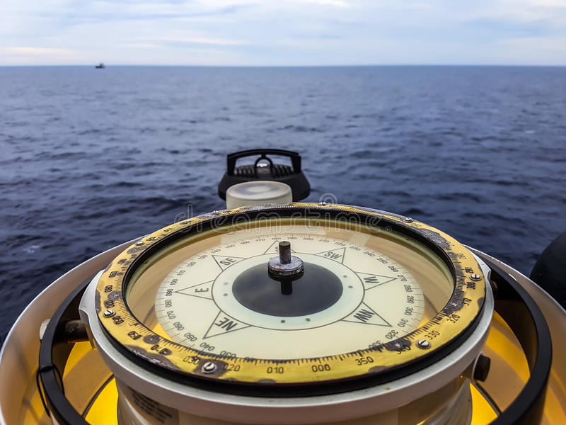Magnetic compass aboard a ship stock photo