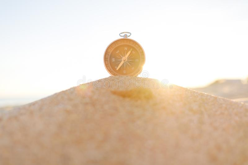 Magnetic compass on sand. stock photo