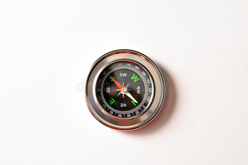 Magnetic compass. Compass, a tool for land navigation, on a white background royalty free stock images