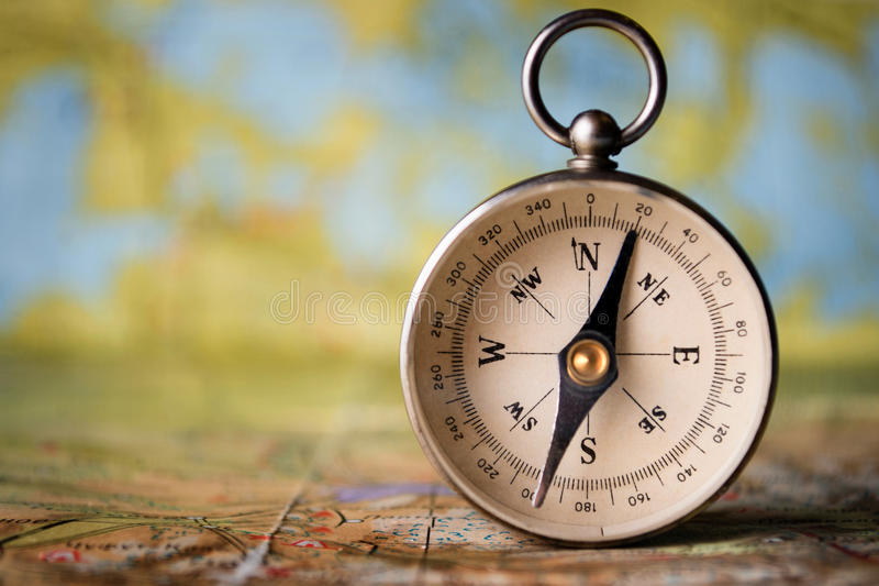 Magnetic compass on a world map stock image