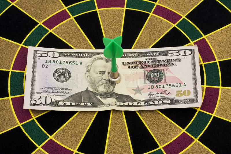 Magnetic Dart Board. With darts � on target with your money stock photography