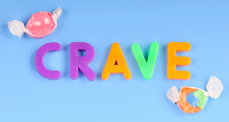 Magnetic letters spelling crave. Magnetic children's letters spelling crave by candy stock photo