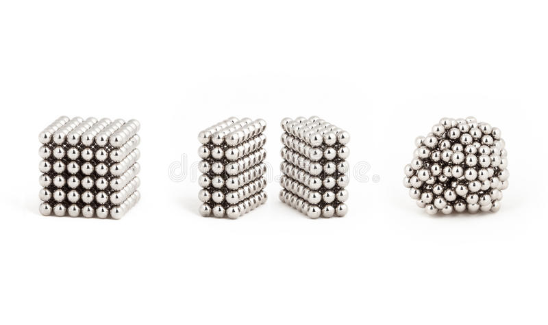 Magnetic metal balls, from ideal shape to chaos. Magnetic metal balls, from the geometry shape to random order stock photos