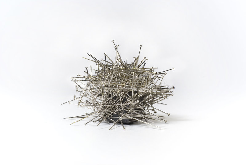 Magnetic needles stock images