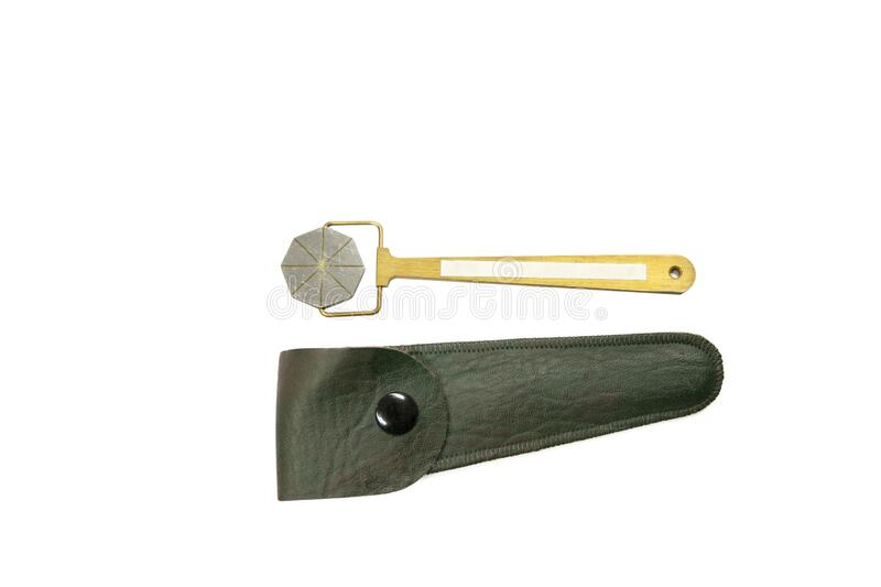 Magnetic Pie Field Indicator, also known as a pie gauge. Is a device used as an aid in determining the direction of magnetic field for detection of stock image