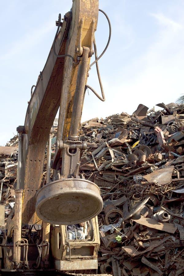Magnetic scrap metal crane stock images
