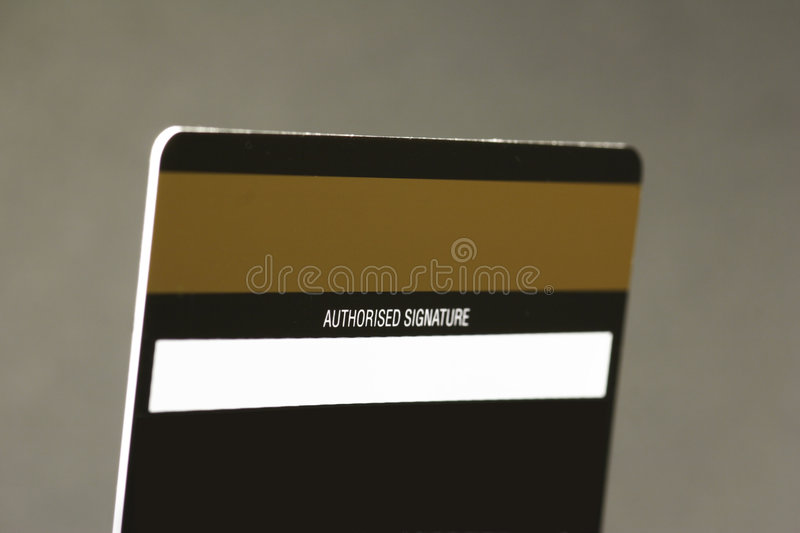 Magnetic strip on reverse side of a credit card