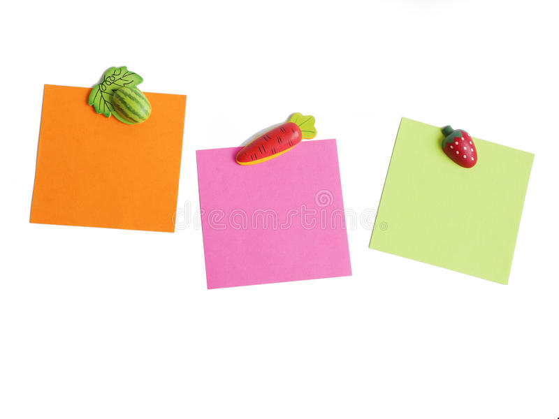 Magnets shaped. And colored notepaper royalty free stock images