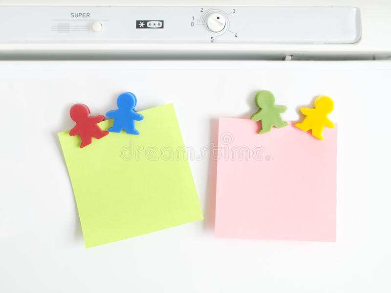 Magnets shaped kids colors with note royalty free stock photos