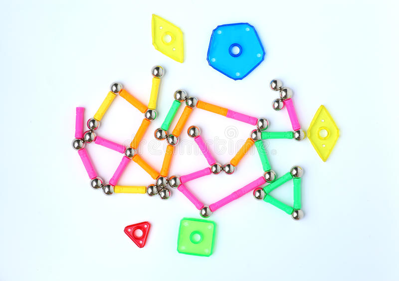 Magnets toy for child brain development. On white background royalty free stock image