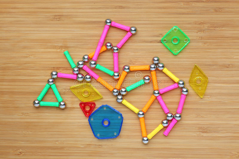 Magnets toy for child brain development. On wood board stock photos