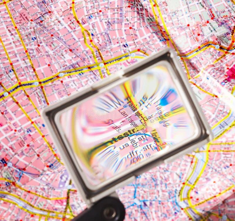 Magnification - Vergroesserung. Lense focusing a roadmap - Lupe vergroessert punkt einer Strassenkarte royalty free stock photo