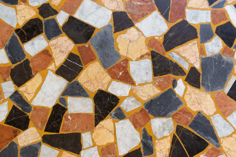 Valletta, Malta, August 2019. Stone mosaic pavement in the city center. A magnificent abstract background of polished pieces of multi-colored marble, randomly stock images