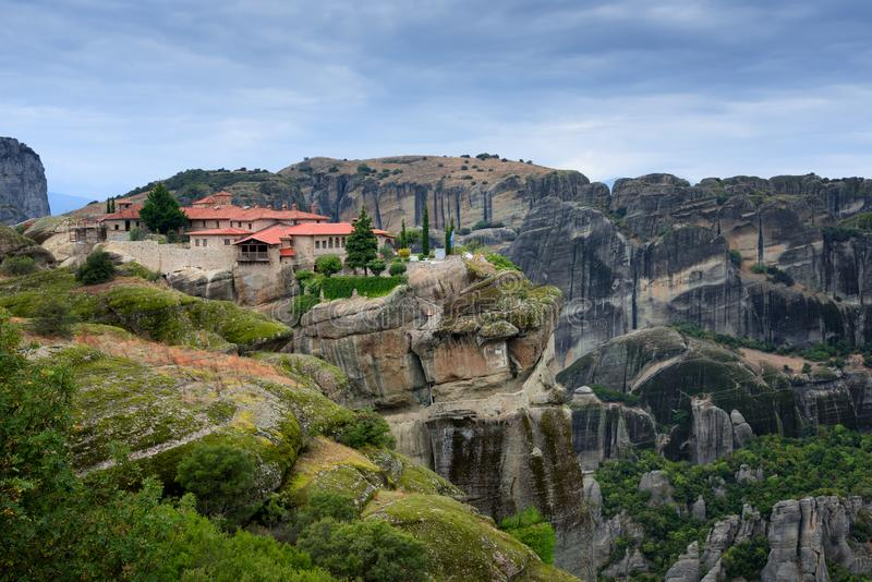 Magnificent autumn landscape. Monastery Holy Trinity, Meteora, Greece. UNESCO world heritage Site. Epic landscape with temple at t stock photo