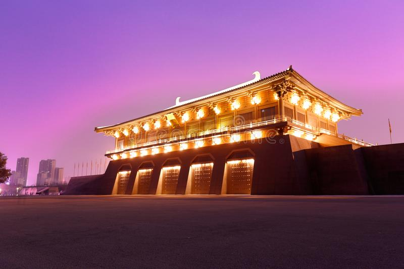 Chinese gate tower of tang dynasty under ultra violet night sky, srgb image. Magnificent chinese gate tower of tang dynasty night sight, xian city, shaanxi stock image