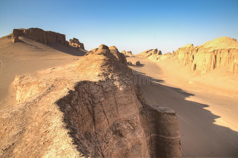 Dasht-e Lut desert near Kerman, Iran. The magnificent Dasht-e Lut deserts, famous for its rock formations called Kaluts or Kalouts near the city Kerman in Iran stock images