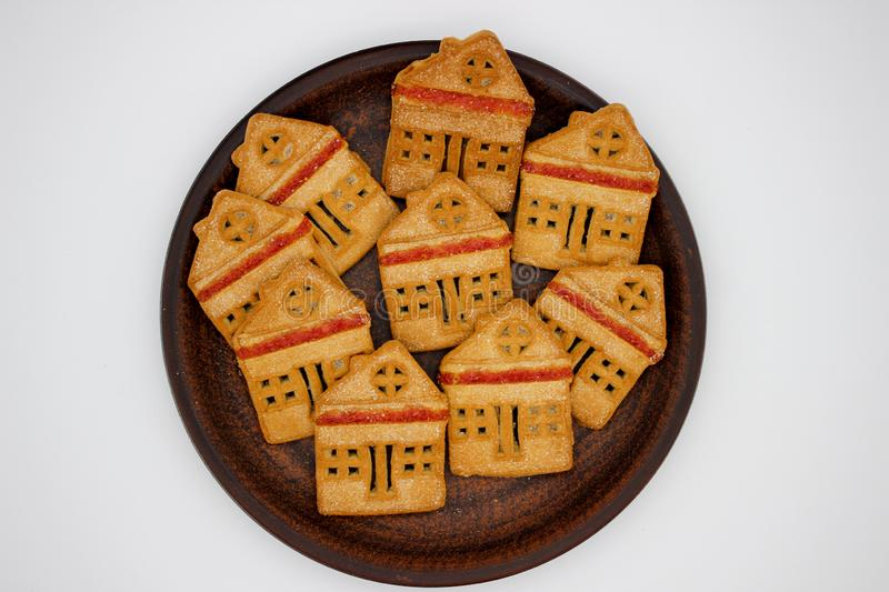 Magnificent And Delicious Cookies In The Form Of A One-Story House With Marmalade, Which Are On A Clay Plate. Isolated Image. Magnificent And Delicious Cookies stock photos
