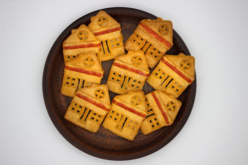 Magnificent And Delicious Cookies In The Form Of A One-Story House With Marmalade, Which Are On A Clay Plate. Isolated Image. Magnificent And Delicious Cookies royalty free stock images