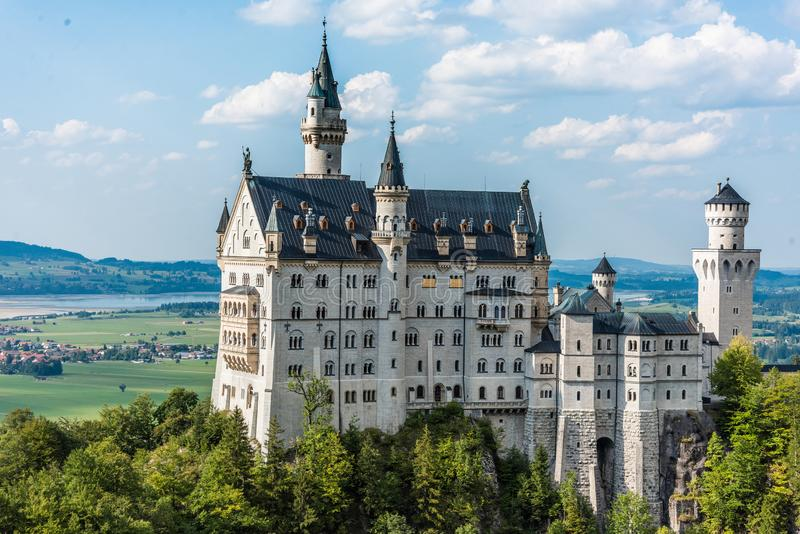 Magnificent fairy-tale castle Neuschwanstein, the main tourist attraction of the Bavarian Alps on a beautiful summer royalty free stock images