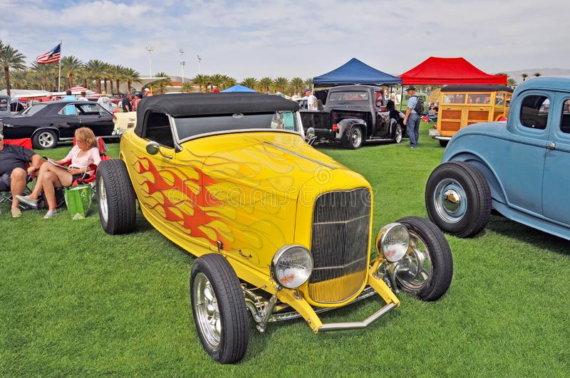 Awesome Yellow High Boy Roadster. This magnificent high boy roadster demonstrates the effort and craftsmanship that goes into a car like this stock photo
