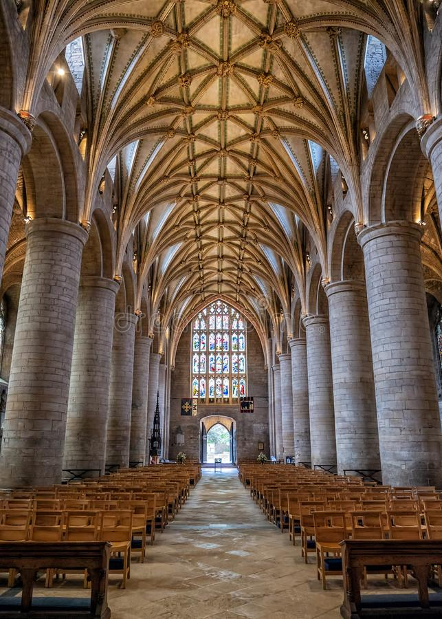 The Nave, Tewkesbury Abbey, Gloucestershire, England. The magnificent and historic Nave of Tewkesbury Abbey looking towards the main entrance. The Nave features stock photo