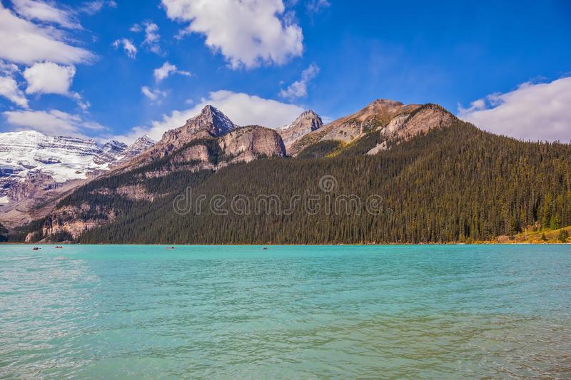 Magnificent Lake Louise, pine forests and glaciers. Banff National Park, Canada, Alberta. Magnificent Lake Louise with emerald green water surrounded by the royalty free stock images