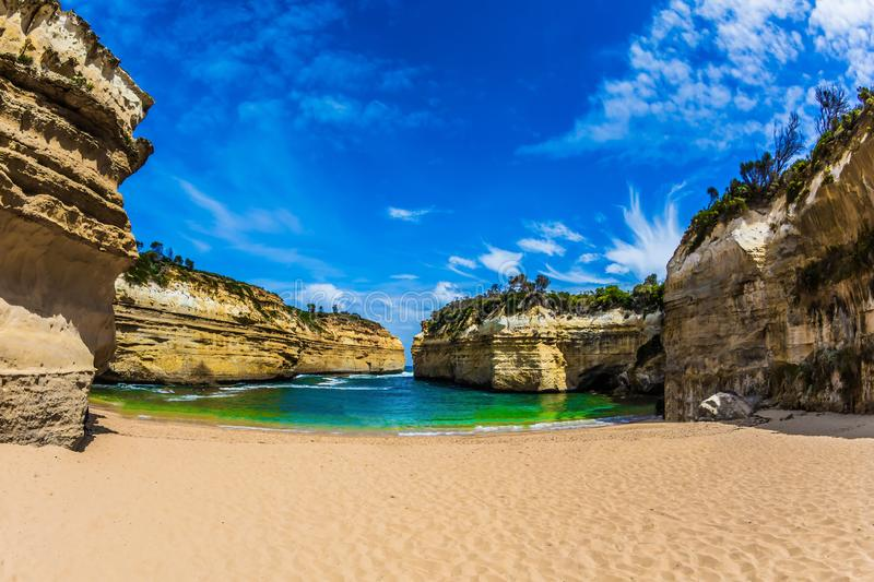 Magnificent little beach in the bay. Of Pacific ocean. The Great Ocean Road of Australia. The concept of exotic, active and photo-tourism stock images