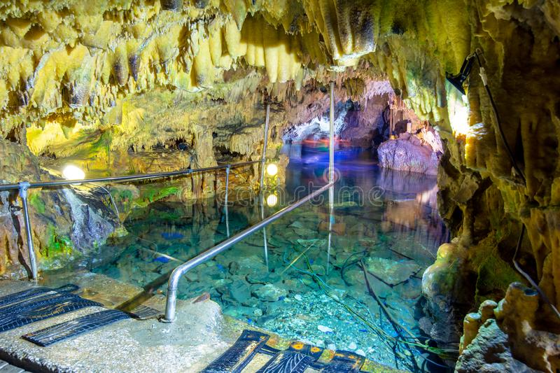 The magnificent and majestic caves of Diros in Greece. A spectacular sight of stalacites and stalagmites. The magnificent and majestic caves of Diros in Greece stock photo