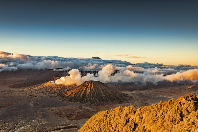 Magnificent Mount Bromo landscape view in high resolution image. Mount Bromo panorama high resolution photo in sunrise with volcanic smoke motion blur from stock photography