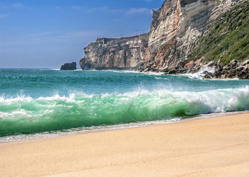 The magnificent sandy beach of the Atlantic Ocean . Portugal, Costa do Prado . The magnificent sandy beach of the Atlantic Ocean . The sheer high cliffs royalty free stock photos