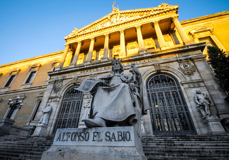 Magnificent sculpture of the Spanish king Alfonso el Sabio in National library, Madrid, Spain royalty free stock images