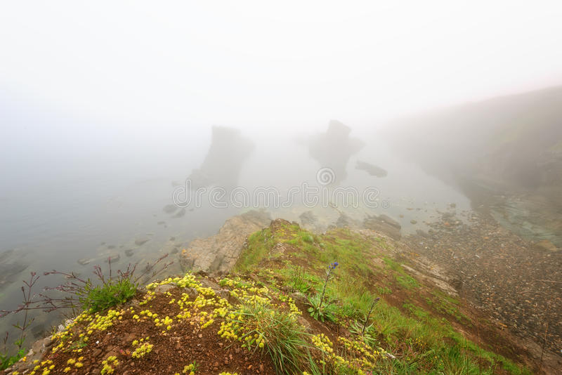 Magnificent seascape over the rock phenomenon The Ships, Sinemorets village, Bulgaria. Foggy weather. stock image