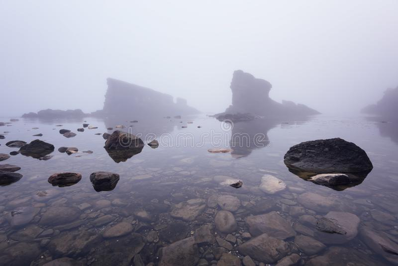 Magnificent seascape over the rock phenomenon The Ships, Sinemorets village, Bulgaria. Foggy weather. stock images