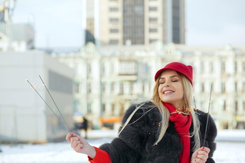 Magnificent smiling blonde girl wearing trendy cap having fun wi royalty free stock photos