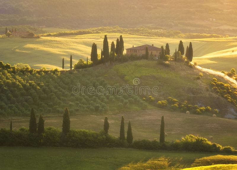Magnificent spring landscape at sunrise.Beautiful view of typical tuscan farm house, green wave hills. Magnificent spring landscape at sunrise.Beautiful view of royalty free stock photos