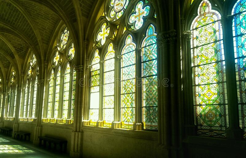 Beautiful stained-glass windows with yellow, green and blue tones. Cathedral of Burgos, Spain. Magnificent stained-glass windows in yellow, green and blue tones royalty free stock images