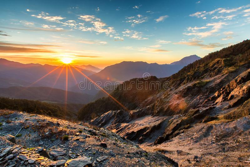 Magnificent sunrise and mountain ranges Hehuanshan, Taiwan. Hehuanshan, Taiwan, is a popular destination for the local people. One can enjoy magnificent sunrise royalty free stock photography
