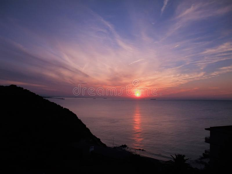 Magnificent sunrise over Cape Salou Spain stock photography