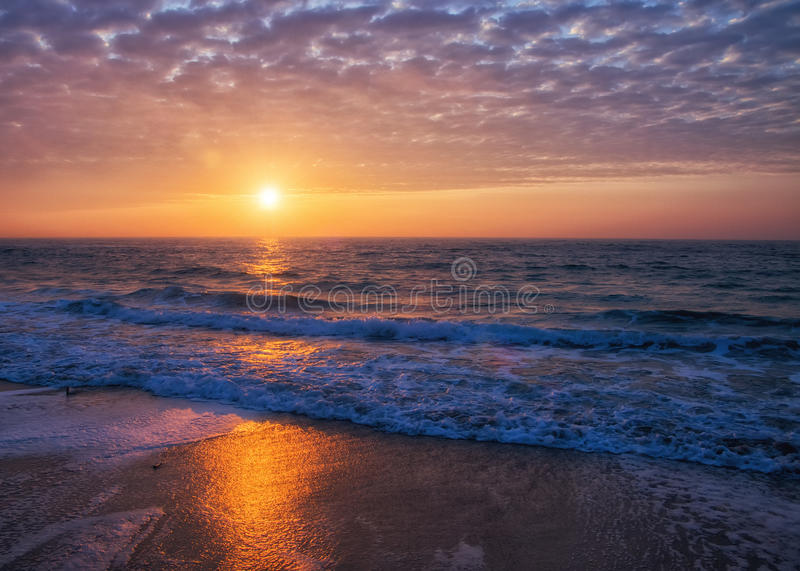 Magnificent sunrise over sea stock images