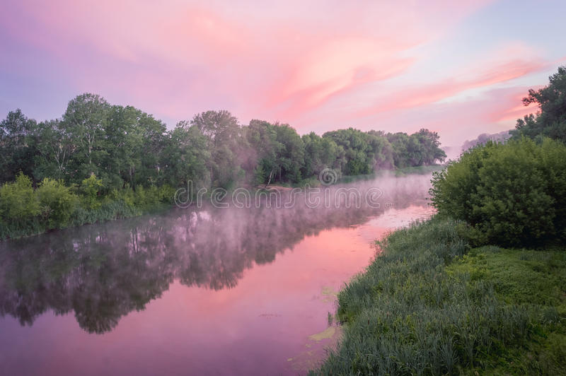 Magnificent sunrise on the river. In the summer with fog over the water royalty free stock images