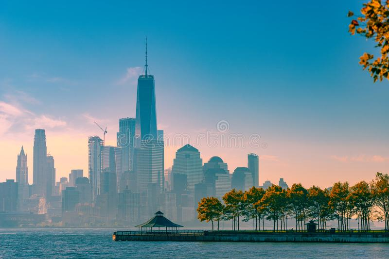 A magnificent view of Lower Manhattan and the financial district at sunset, New York City. America, antenna, apartment, architecture, boat, building, business royalty free stock image