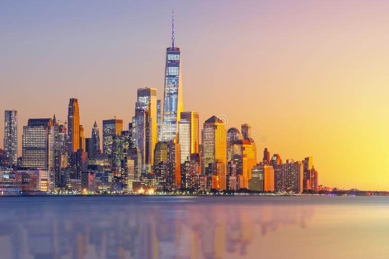 A magnificent view of Lower Manhattan and the financial district at sunset, New York City. America, antenna, apartment, architecture, boat, building, business royalty free stock photography