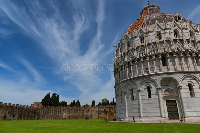 Magnificent daily view at the Pisa Baptistery of St. John, the largest baptistery in Italy, in the Square of Miracles Piazza dei. Miracoli, Pisa, Italy royalty free stock images